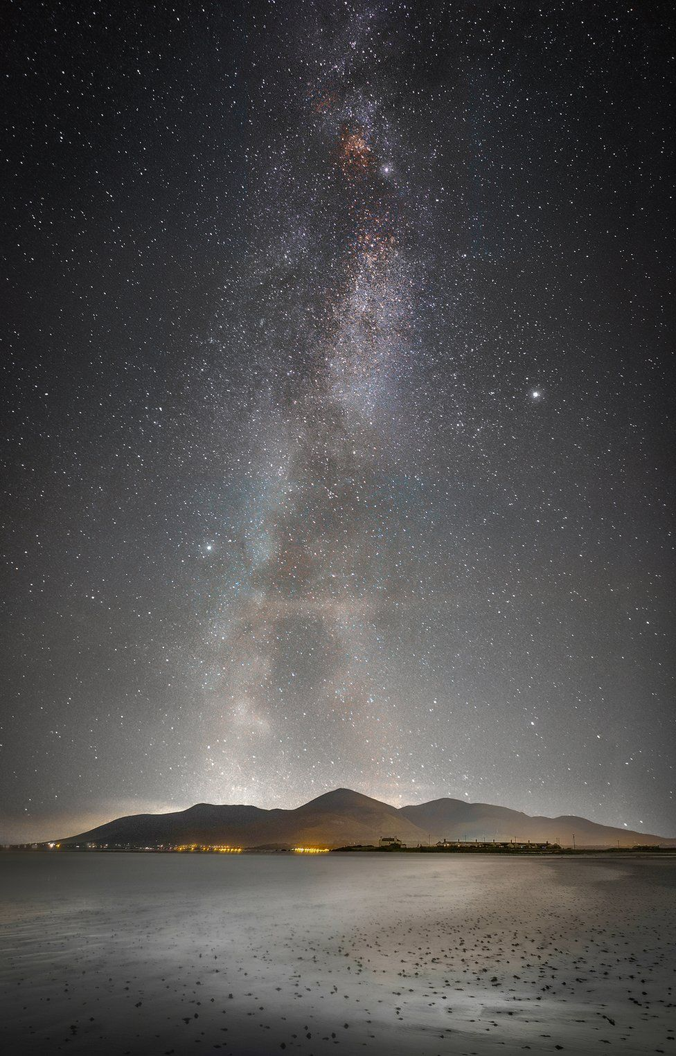 The Milky Way over the Mourne mountains as seen from Tyrella Beach in County Down