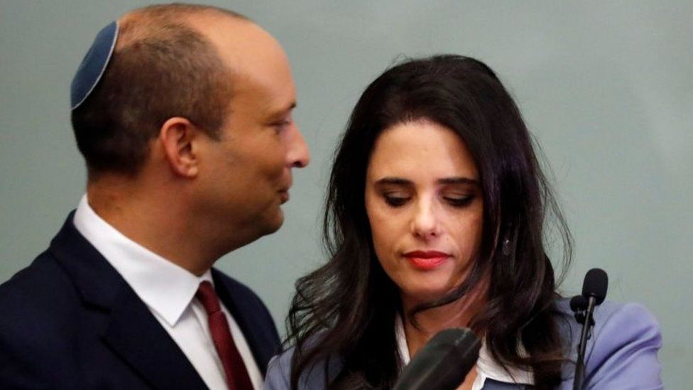 Israeli Education Minister Naftali Bennett (L) and Justice Minister Ayelet Shaked (R) are seen together as they give a statement at the Knesset in Jerusalem on 18 November 2018.