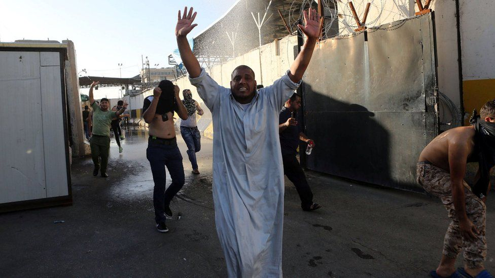 Anti-government protesters storm Baghdad's Green Zone in Iraq on 20 May