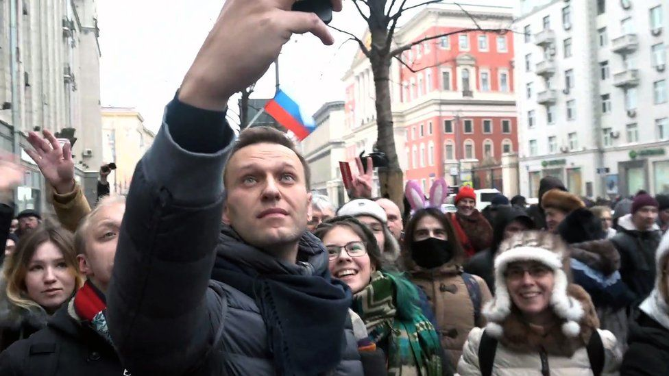 Alexei Navalny takes a selfie with protesters in Moscow.