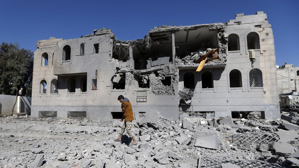A Yemeni man checks the remains of a Houthi-run detention centre in the capital Sanaa after a Saudi-led coalition air strike (13 December 2017)