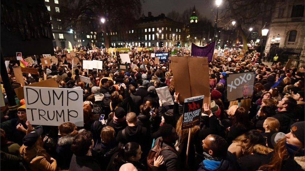 Demonstrators protest outside Downing Street against US President Donald Trump in central London on January 30, 2017