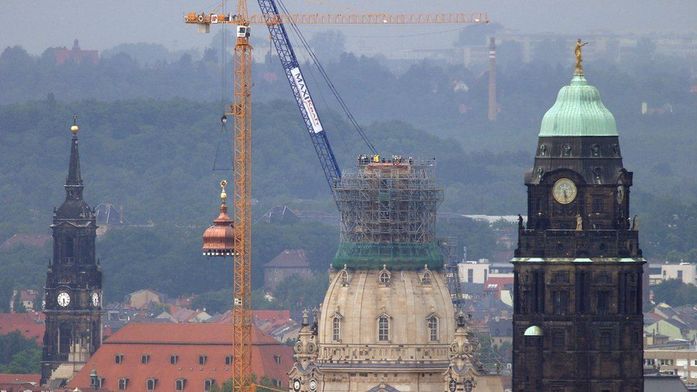 A crane lifts a cupola on top of Dresden cathedral in 2004