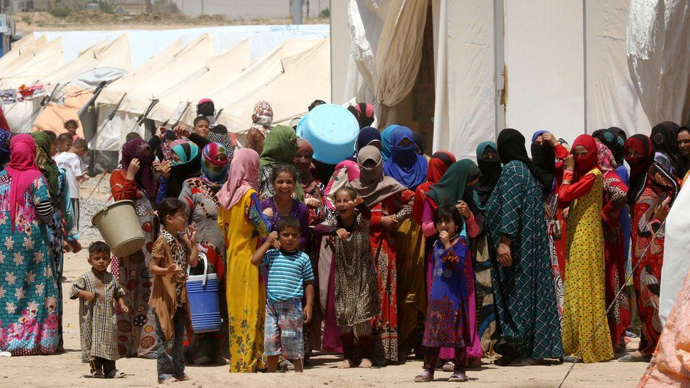 Displaced families from Mosul at a camp in Iraq