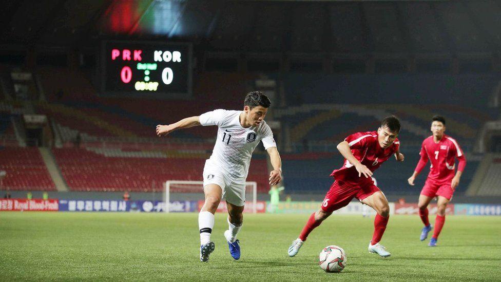 South Korea v North Korea match in front of empty stadium