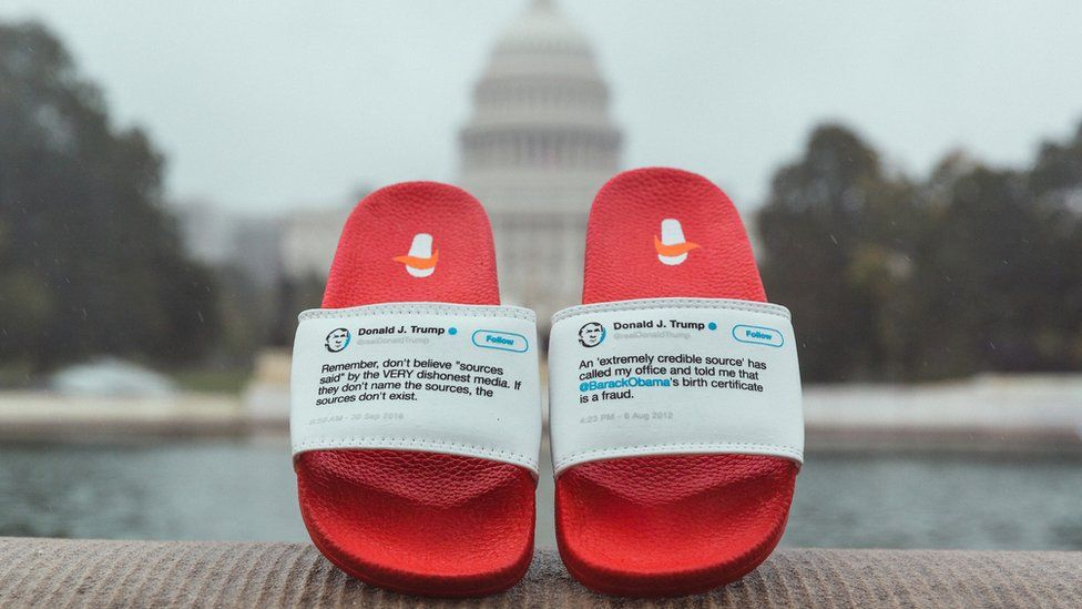 Anonymous Sourcing flip flops posed in Washington DC