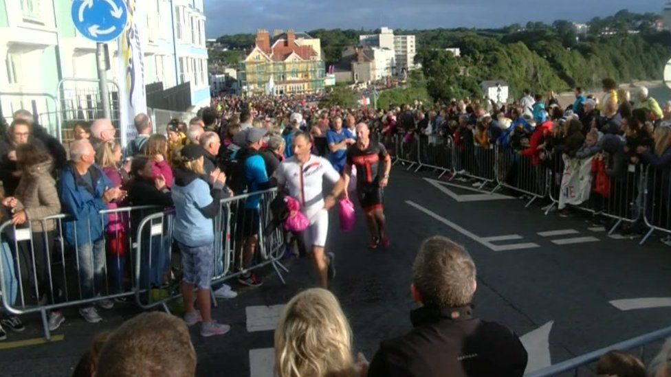 People lined the streets in Tenby to watch the seventh Ironman Wales
