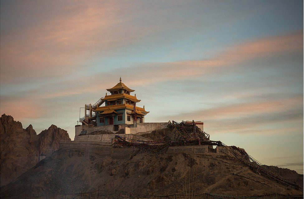 A Buddhist temple sits on top of a hill