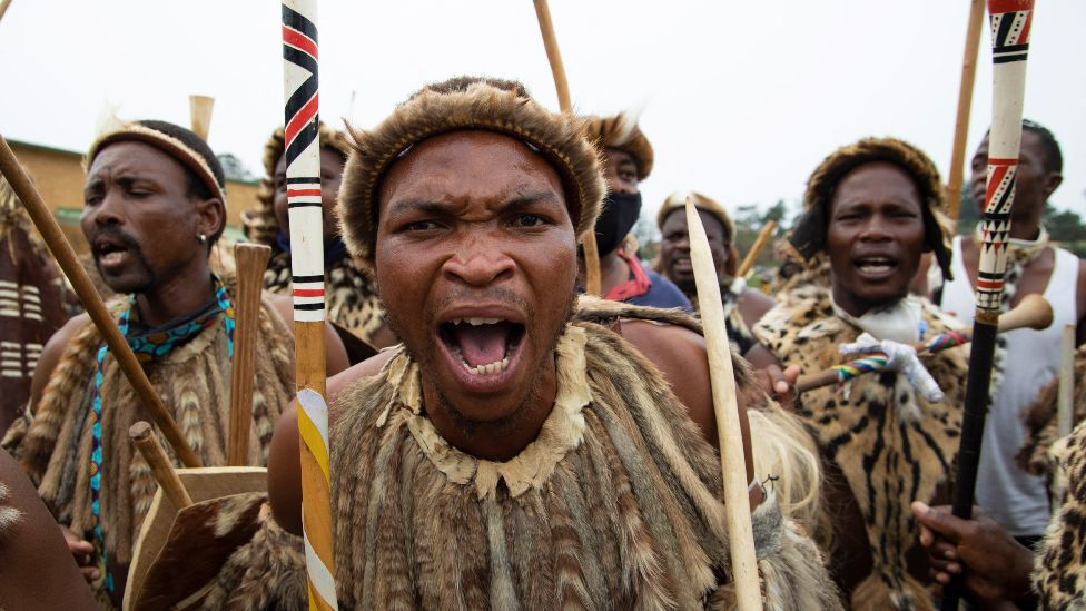 Zulu men in traditional warrior outfits in Nongoma, South Africa - 17 March 2021