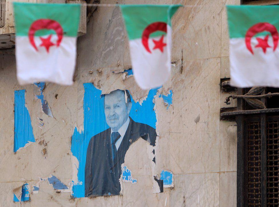 A views shows an old poster of former Algerian President Abdelaziz Bouteflika.