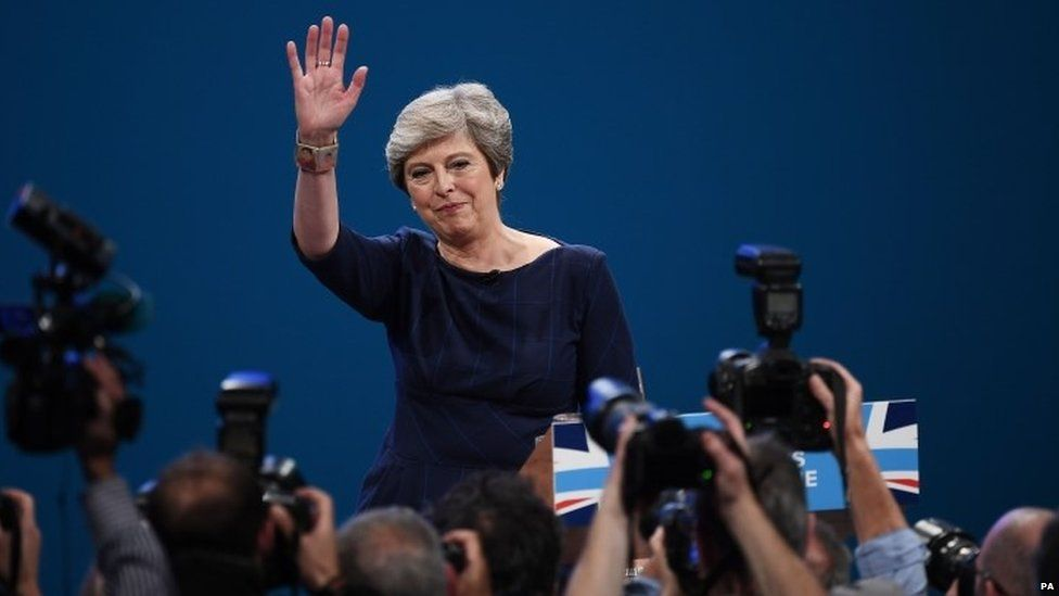 Theresa May at the end of her speech in Manchester
