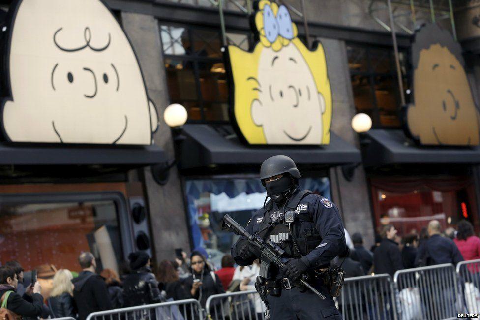 A policeman outside Macy's in Manhattan, New York, 23 November