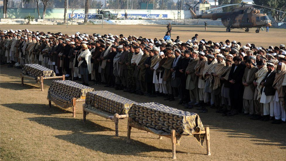 Funeral prayers for victims of a suicide bomb attack targeting pro-government provincial politician Obaidullah Shinwari in Jalalabad in January 2016