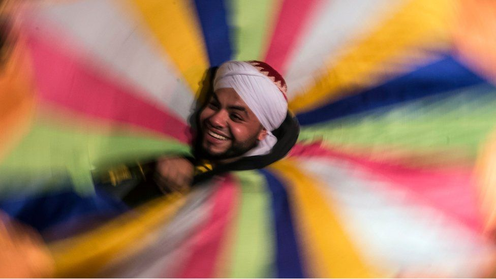 An Egyptian dancer performs the Tanoura during the holy fasting month of Ramadan, at el-Ghuri culture Palace in Cairo on May 22, 2018.