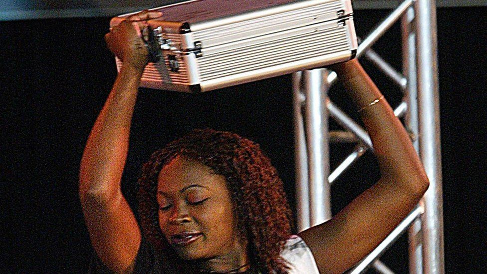 Cherise Makubale, 24, dances with a briefcase containing around £76,000 after winning Big Brother Africa in 2003.
