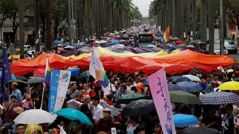 Participants hold a giant rainbow flag as they take part in the lesbian, gay, bisexual and transgender (LGBT) pride parade in Taipei, Taiwan on 29 October 2016.