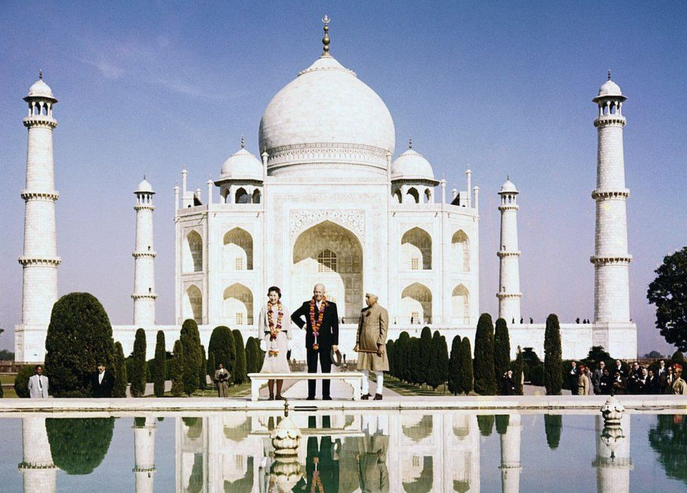 President Eisenhower, daughter-in-law Barbara, and Indian Prime Minister Jawaharlal Nehru (right) stand before the famed Taj Mahal, their images reflected in the pond at their feet
