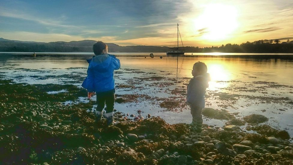 Children play by Loch Etive