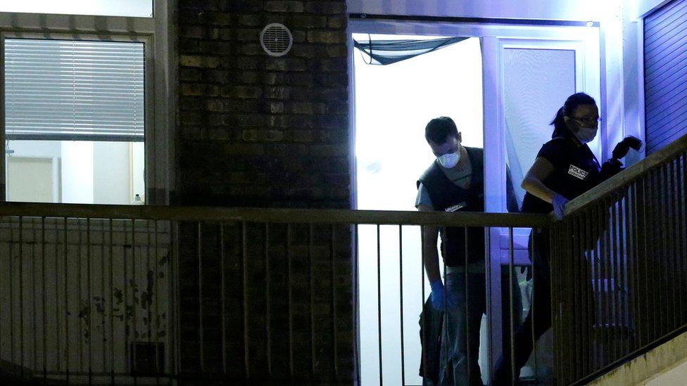 French police investigate an apartment during a police raid in Boussy-Saint-Antoine near Paris, France, on Thursday