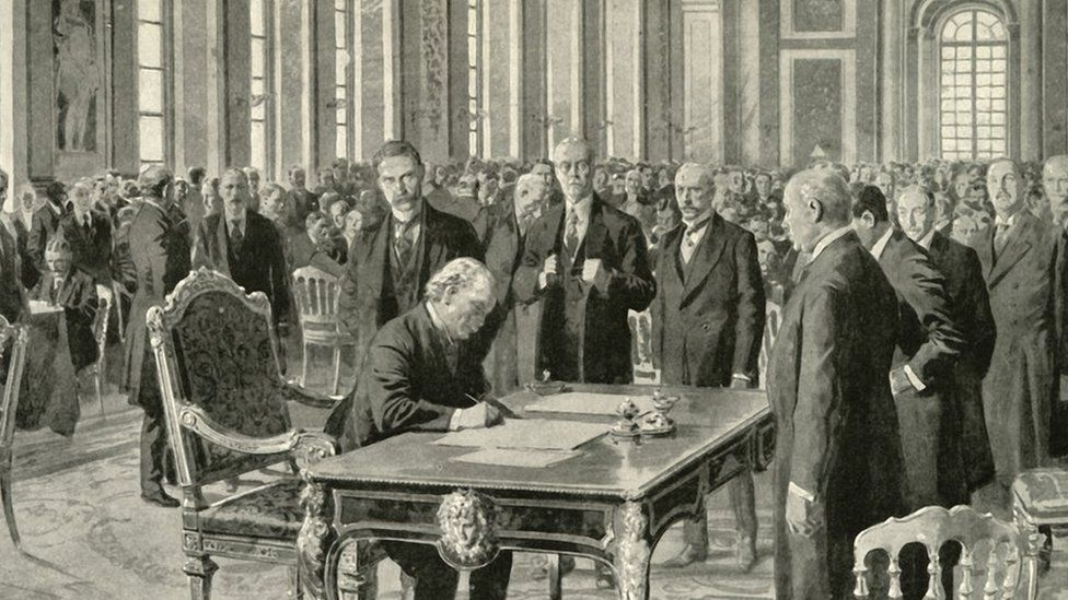 The prime minister of Britain signing the Versailles Treaty in June 1919