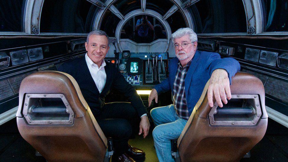 Bob Iger (left) andStar Warscreator George Lucas inside Millennium Falcon: Smugglers Run at Star Wars: Galaxy's Edge at Disneyland Park in California