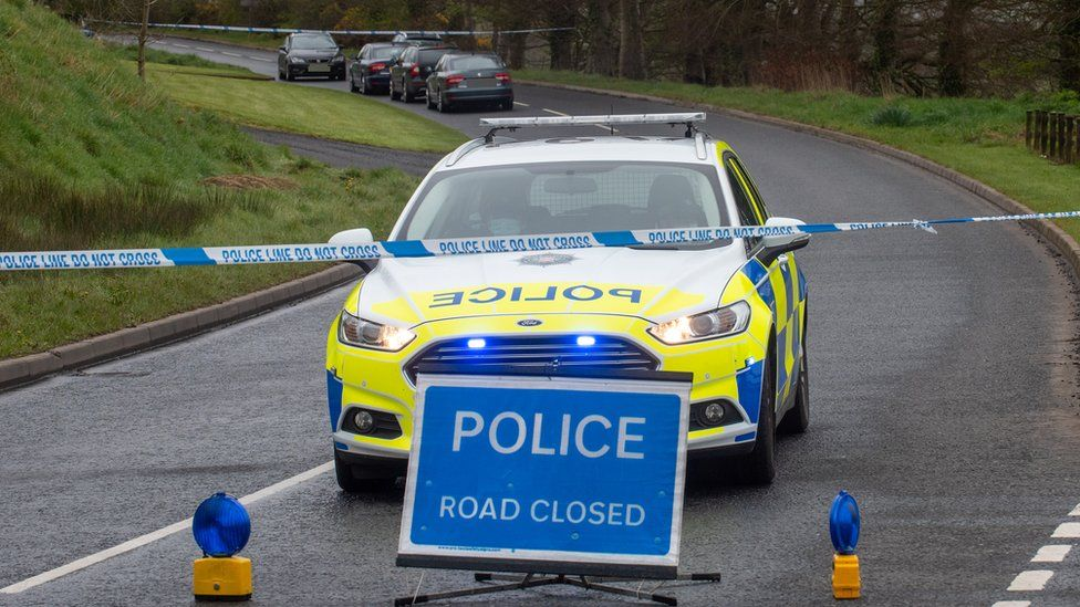 Police vehicles at the closed Ballyquin Road near Dungiven