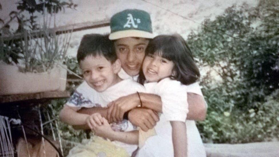Jose with one of his brothers and a niece in the 90s
