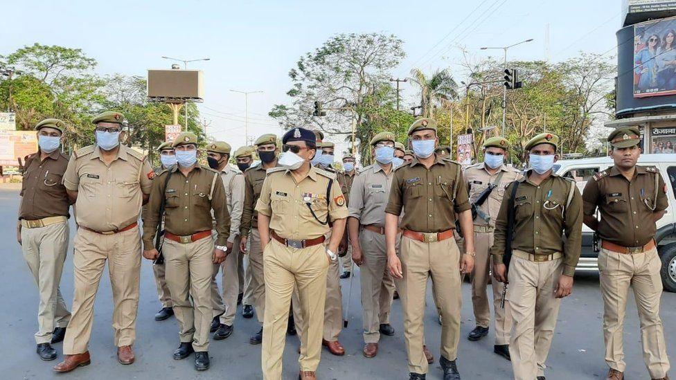 Indian police patrolling wearing face masks