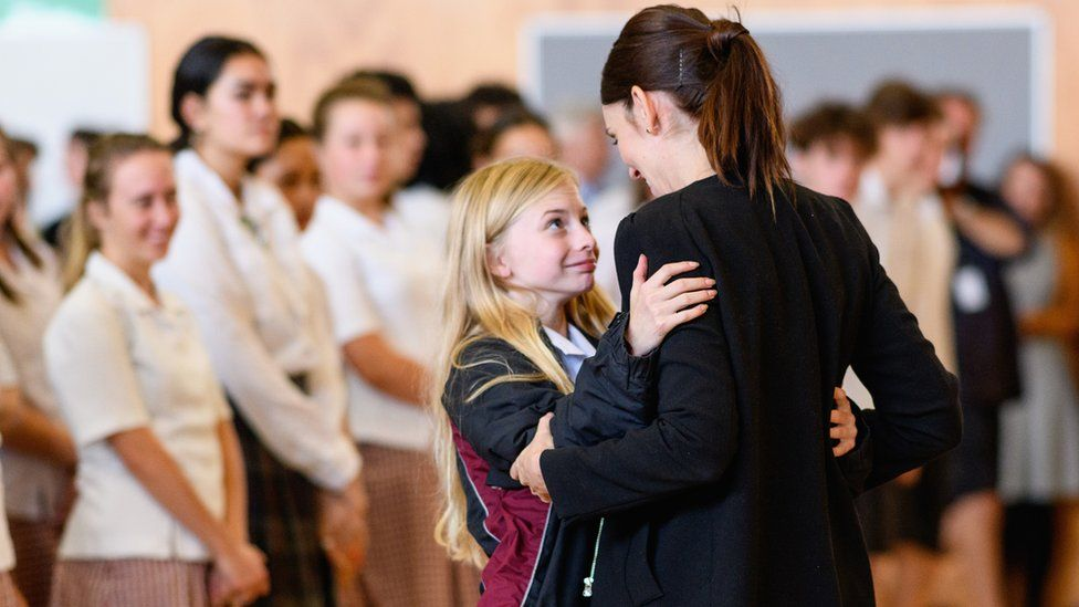 New Zealand Prime Minister Jacinda Ardern receives a hug from a student during her visit to Cashmere High School on March 20, 2019 in Christchurch