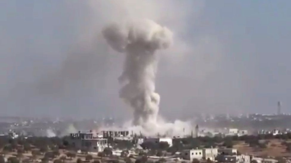 Video provided by Revolutionary Forces of Syria, an opposition activist media organisation, purportedly showing smoke rising from village of Haas, Idlib province, after air strike on 26 October 2016