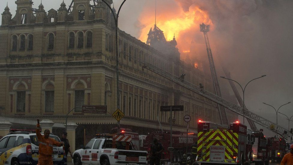 Fire-fighters work to douse the flames at the Portuguese Language Museum in Sao Paulo, Brazil, Monday, Dec. 21, 2015