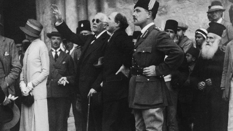Arthur Balfour (arm raised) in Jerusalem in 1925