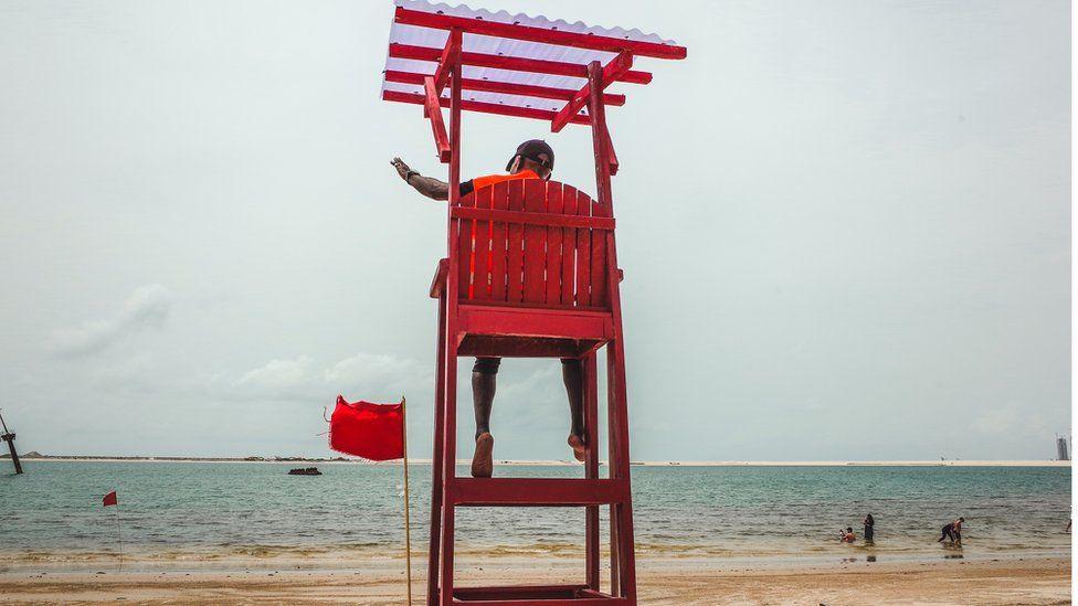 Stephen Boboly on lifeguard chair on Landmark Beach, Lagos, Nigeria