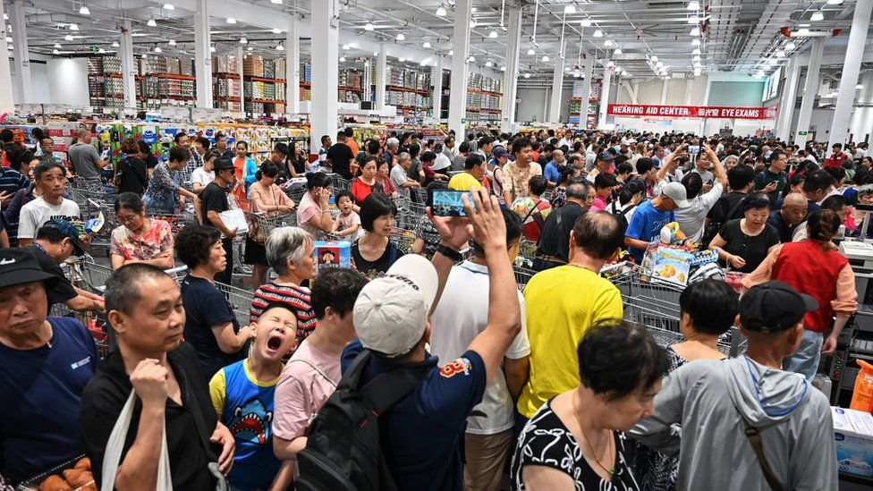 People visit the first Costco outlet in China, on the stores opening day in Shanghai on August 27, 2019
