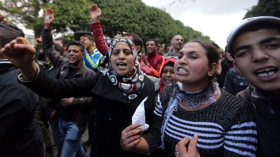 Unemployed graduates shout slogans during a demonstration urging the government to provide them with job opportunities, in Tunis, Tunisia, 22 January 2016.