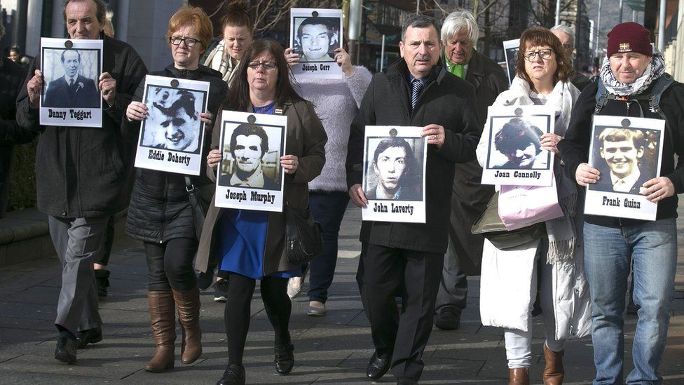 Families of those killed in Ballymurphy with images of their relatives