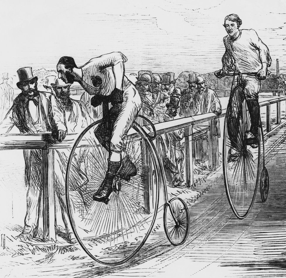 An engraving showing a Penny Farthing bicycle race in London, circa 1860