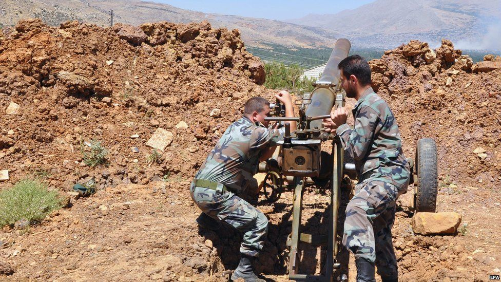 Syrian Arab News Agency image shows Syrian army soldiers during a artillery operations in Zabadani. 9 July 2015