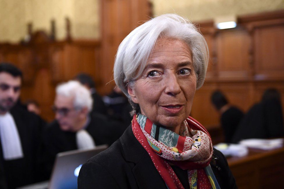 International Monetary Fund chief Christine Lagarde, right, arrives at the special Paris court, France, 12 December