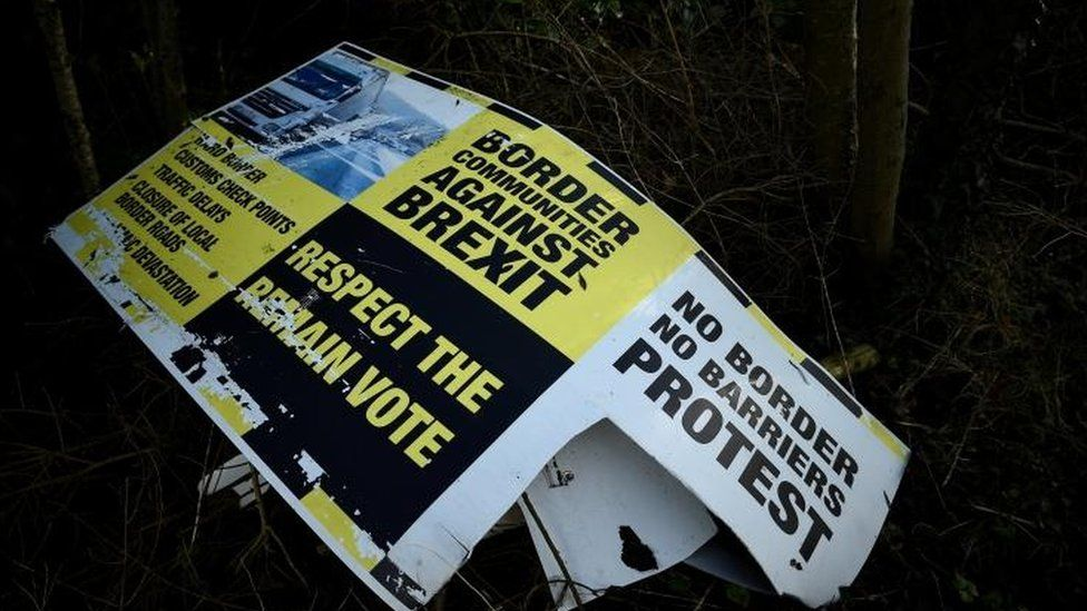 Discarded Brexit signage is seen between Donegal in the Republic of Ireland and Londonderry in Northern Ireland
