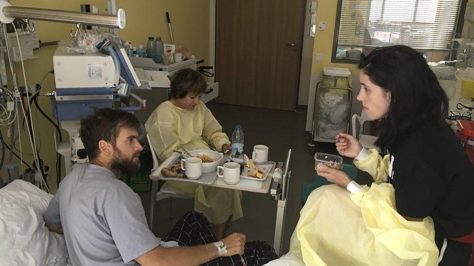Pyotr Verzilov, left, speaks to Pussy Riot founder Nadezhda Tolokonnikova in hospital