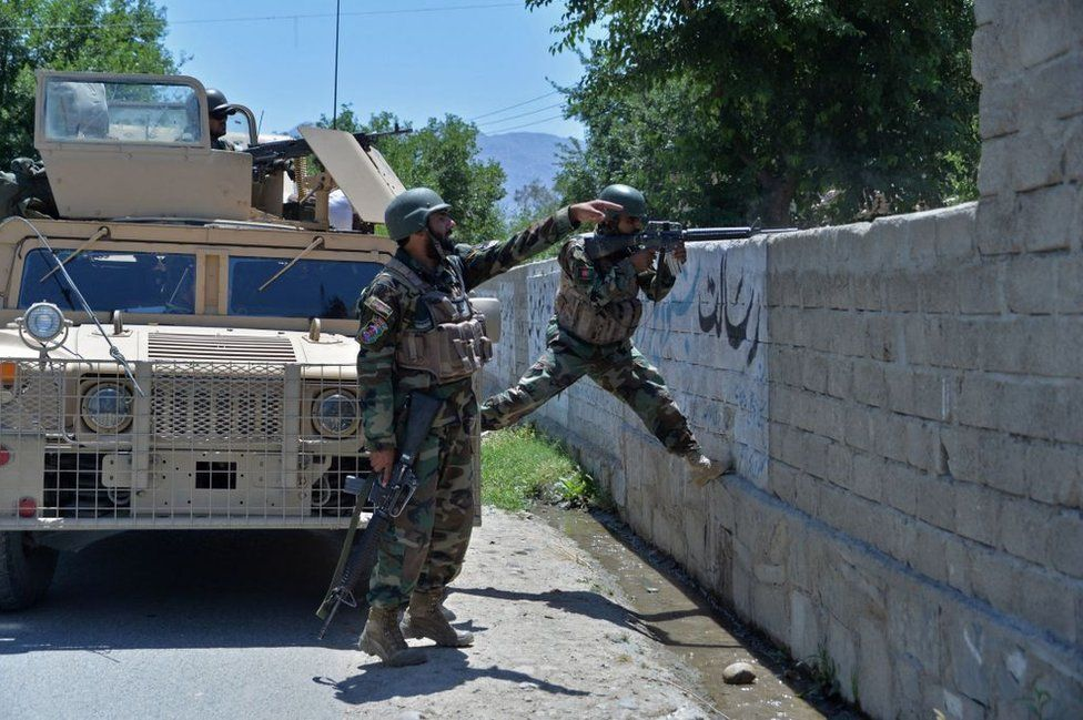 Members of Afghan security forces take their positions during an ongoing clash between Taliban and Afghan forces in Mihtarlam, the capital of Laghman Province, on 24 May, 2021