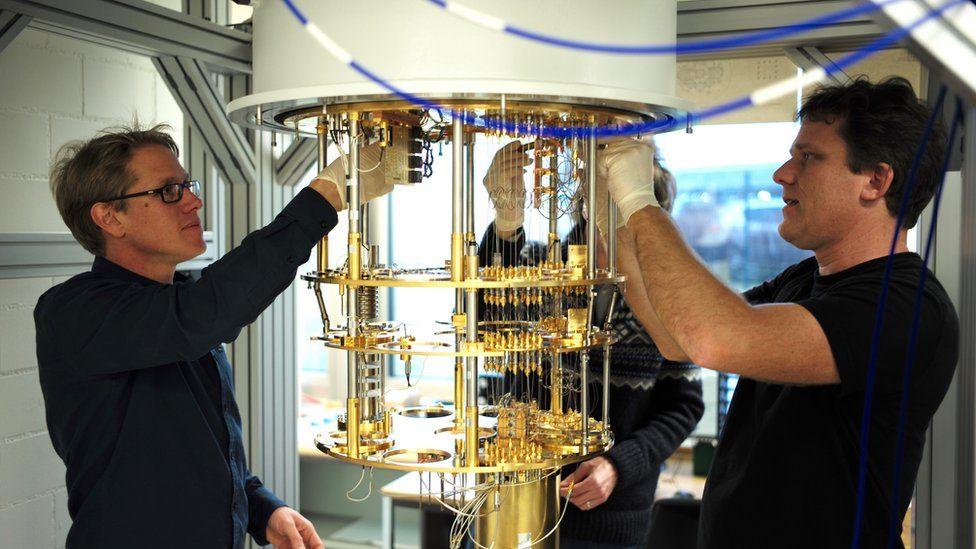 IBM staff building the fridge to store qubits at freezing temperature
