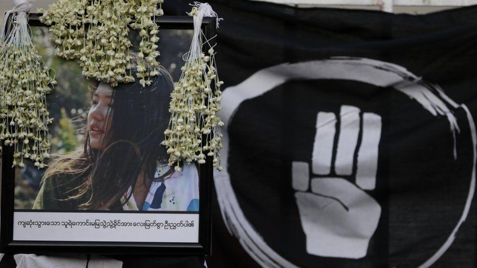 Flowers lay over the image of Mya Thwe Thwe Khaing