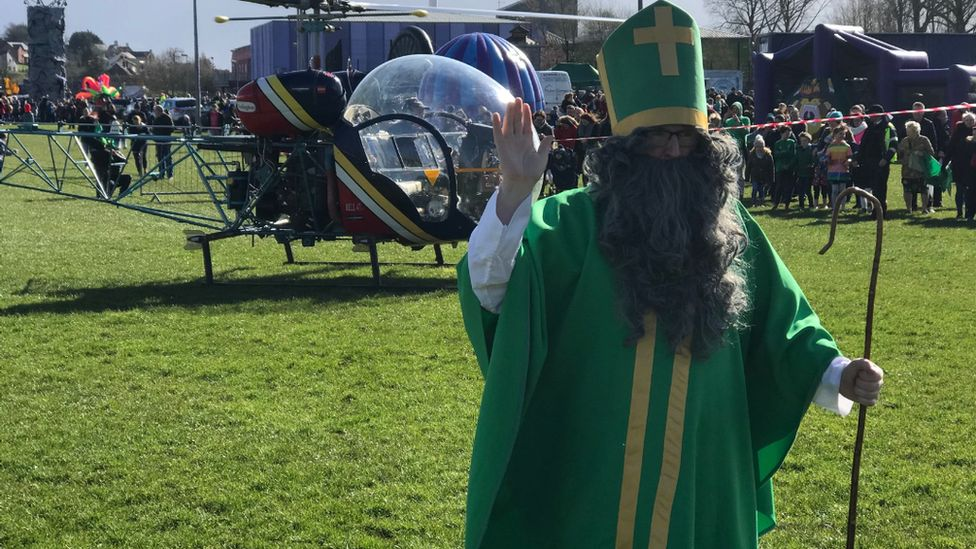 St Patrick waving at the crowds after landing for the celebrations by helicopter