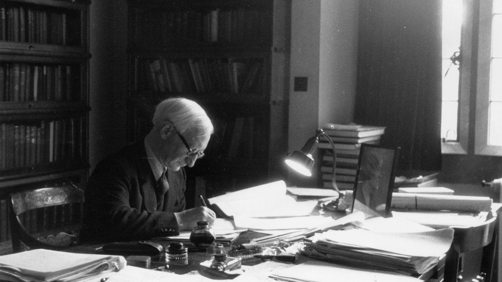 Sir William Beveridge at work in his office at University College, Oxford