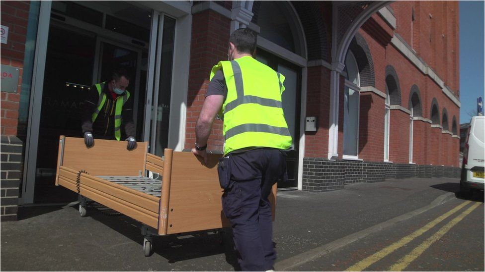 Workers bringing equipment into the Ramada hotel as part of its transformation