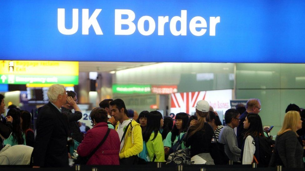 Passengers at Heathrow Airport border control