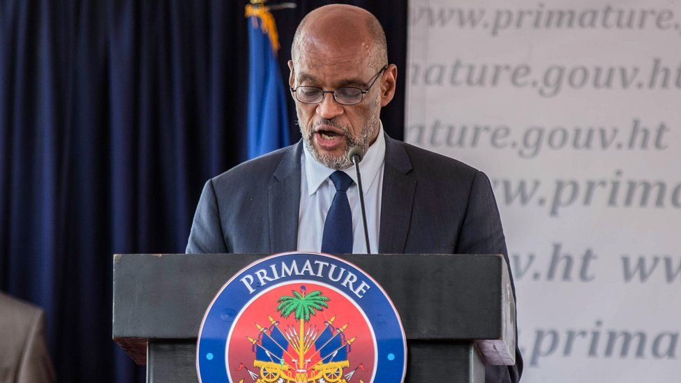 Ariel Henry speaks during a conference as he takes office as Prime Minister of Haiti at the Prime Minister's Office on July 20, 2021