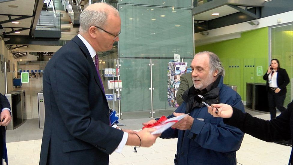 Matthew Hicks receives a petition against Sizewell C